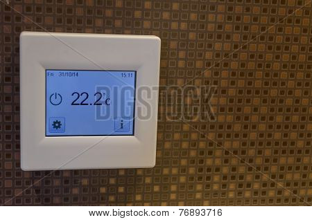Electronic thermometer in bath-room wall