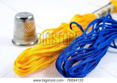 Two Balls Of Cotton Blue And Yellow