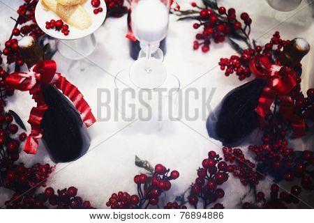 Christmas and happy new year composition, glasses of champagne in artificial snow