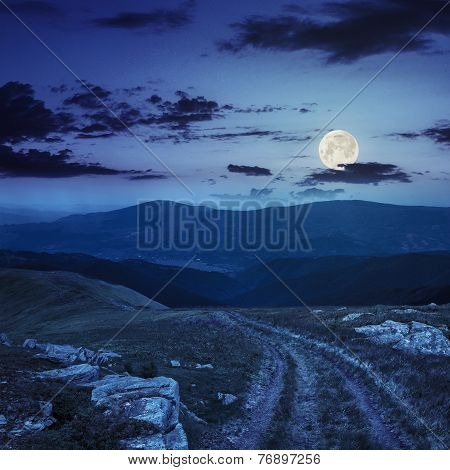 Road Among Stones On The Hillside At Night