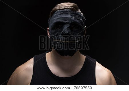Photo of the young man in handmade mask
