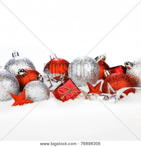 Christmas card with beautiful red and silver decorations in snow
