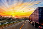 pic of travel trailer  - Truck traveling on road at sunrise - speed and delivery concept. ** Note: Shallow depth of field - JPG
