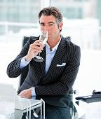 picture of glass water  - Confident businessman drinking a glass of water in the office - JPG