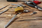 foto of pick-lock  - Tools of picking locks on wooden table - JPG