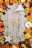 stock photo of christmas spices  - Dried fruits and christmas spices on wooden background - JPG