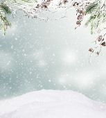 stock photo of snowy hill  - Snowy winter hill with spruce branches and free space for text - JPG