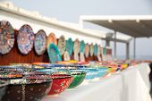 stock photo of pottery  - Collection of turkish traditional hand painted pottery bowls in souvenir shop - JPG