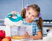 foto of cake-mixer  - little cute girl with a mixer whisk the eggs in the kitchen at home - JPG