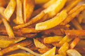 pic of solanum tuberosum  - Golden French fries potatoes ready to be eaten - JPG