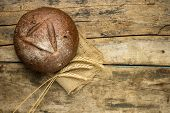 picture of husbandry  - Fresh rye bread with wheat ears on wooden table - JPG