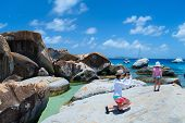 pic of virginity  - Mother photographing her little daughter at The Baths beach area major tourist attraction at Virgin Gorda - JPG