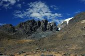 stock photo of tatas  - Trata Tata massif is in Huancasayani valley in bolivian Apolobamba - JPG