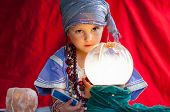 foto of fortune-teller  - little child plays to be a fortune teller - JPG