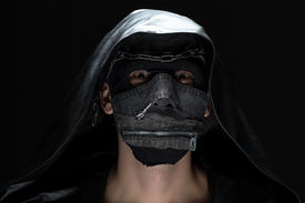 stock photo of madman  - Portrait of madman in handmade mask on black background - JPG