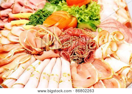 Meat Sausage Slices Assortment On Party Plate