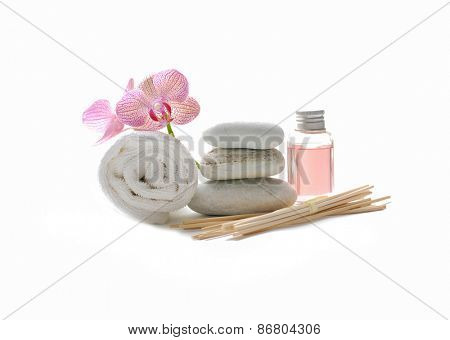 spa setting with towel with branch orchid ,oil