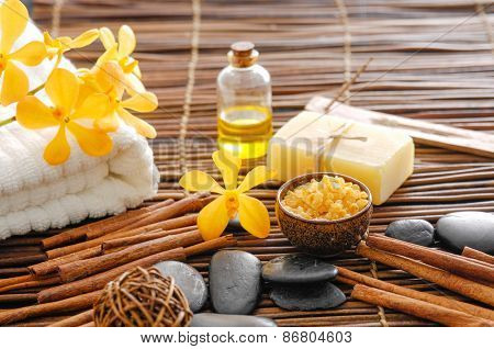 Spa setting with orchid with oil ,stones ,towel, soap with mat