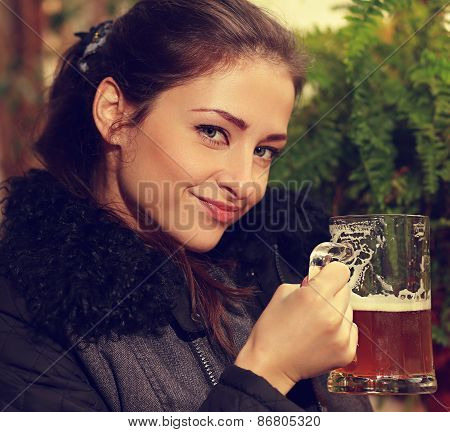 Beautiful Smiling Woman Holding Mug Of Lager Beer. Closeup Portrait