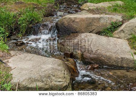 Stream Rushing Around Boulders