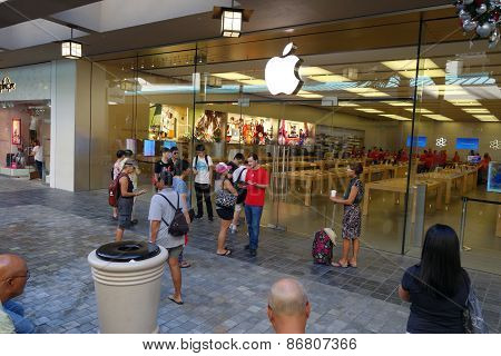 Customers Wait Outside For The Apple Retail Store Opening As Employees Prepare Inside