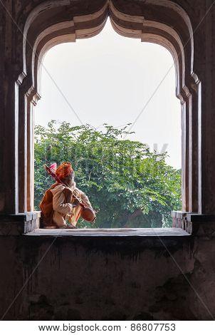Sadhu Sitting And Playing The Tumbi At Window Of Chaturbhuj Temple