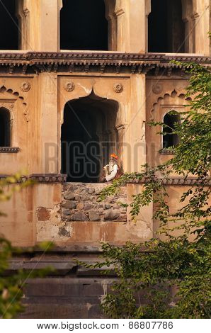 Sadhu Sitting At Window Of Chaturbhuj Temple