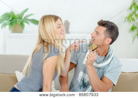Couple fighting over a credit card
