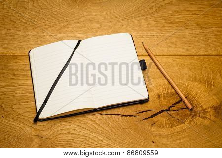 Empty Pages Notebook Pencil Skew On Desk