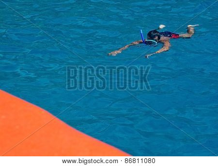 Snorkler and boat