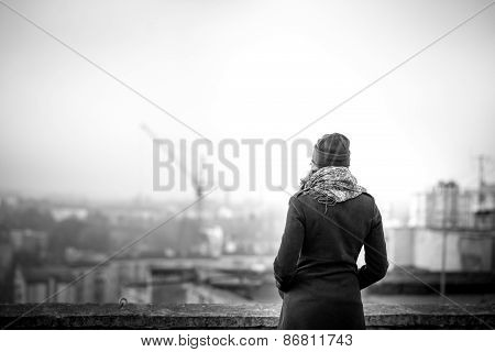 Girl On The Top Of High Building