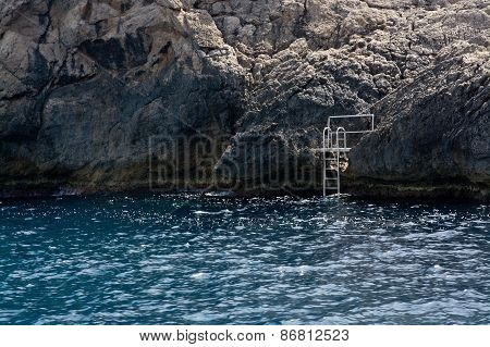 Ladder on a cliff