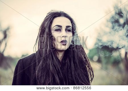 Long Hair Girl With Scary Makeup In The Forest