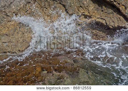 Cliff and seafoam closeup