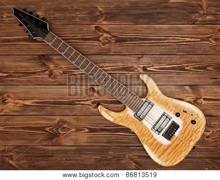 Modern 7 string electric guitar with natural finish