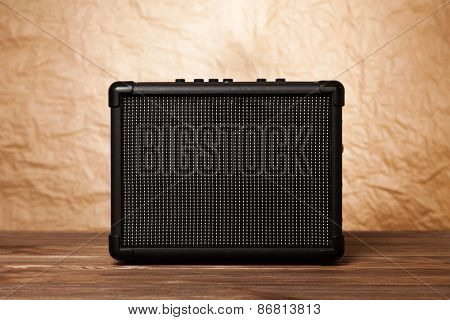 Guitar amplifier on yellow background.