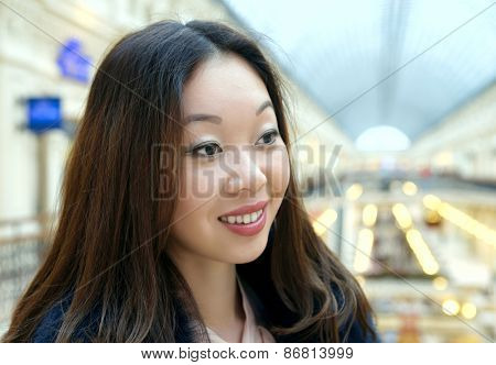 Beautiful Korean girl smiles shyly.