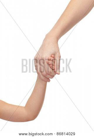 people, charity, family and adoption concept - close up of woman and little girl holding hands