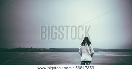 Pretty Young Girl Outdoor With Frozen Lake On Background