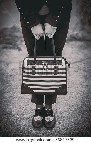Girl With Black And White Bag In The Hands