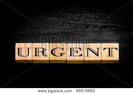 Word Urgent Isolated On Black Background