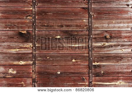 Wooden background with metal decorations.