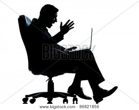 one  business man computer computing sitting in armchair silhouette Full length in studio isolated on white background