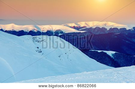 Mountain range glowing by warm sunlight at twilight. View from ski resort Dragobrat. Dramatic morning scene. Carpathian, Ukraine, Europe. Beauty world.