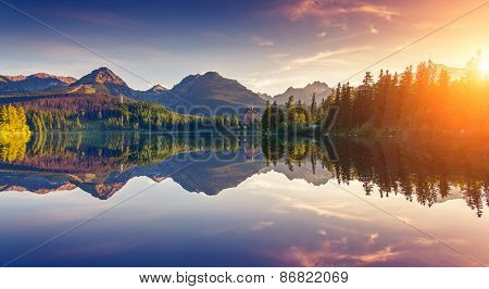 Fantastic mountain lake in National Park High Tatra. Dramatic scenery. Strbske pleso, Slovakia, Europe. Beauty world. Soft filtered and vintage effect. Instagram toning. Double exposure effect.