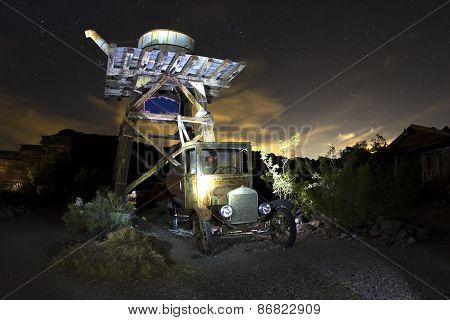 Antique Car Under Water Tower At Night