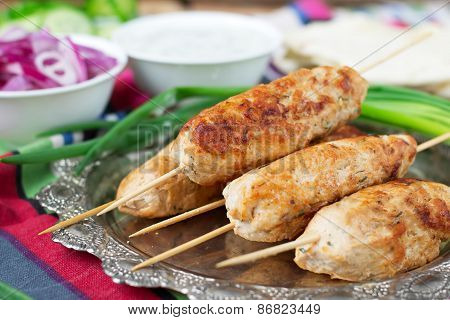 Chicken Kebab With Vegetables, Sauce And Pita