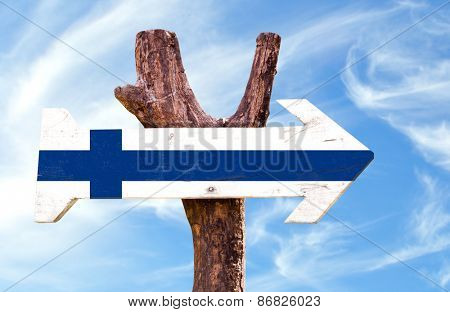 Finland flag wooden sign with sky background