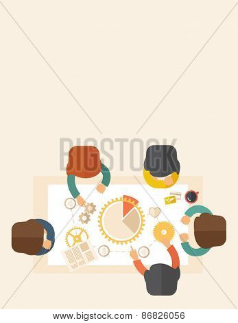 A meeting  of a business people sitting facing each other in the office with coffee and papers on the table in front of them. Sharing and gathering ideas for their marketing plan. Teamwork concept.