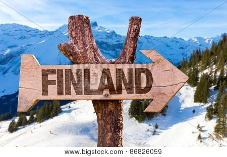 Finland wooden sign with alps background
